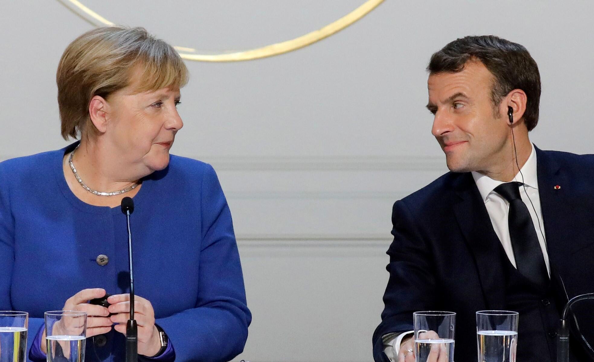 Bild zu Angela Merkel, Emmanuel Macron