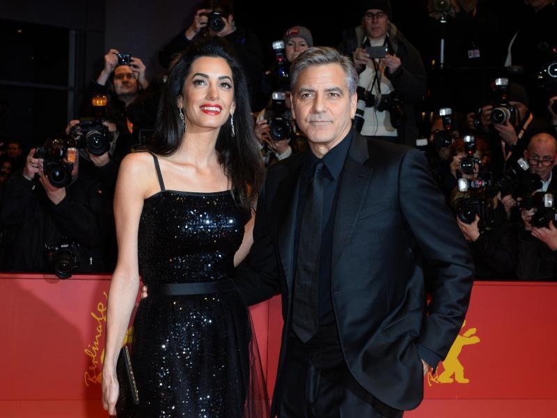 Bild zu Goerge und Amal Clooney