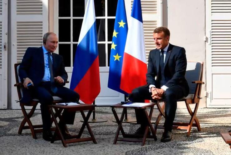 Bild zu Putin und Macron