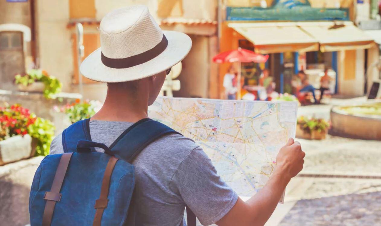 Bild zu Urlauber, Landkarte, Urlaub, Reise
