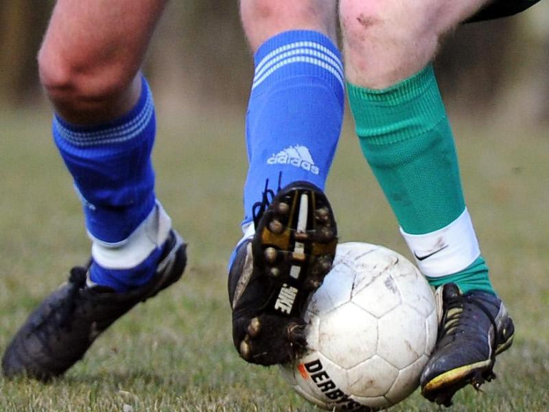 Bild zu Fussballer in Aktion